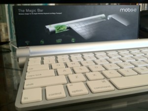 The Magic Bar installed in a keyboard, Charging Dock, and Box